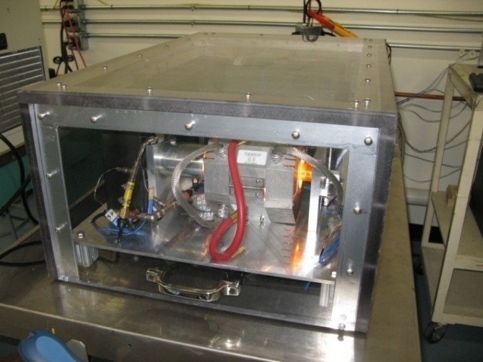 Figure 4. Rotating Heat Pipe Test Apparatus during RHP testing (the glow is from the IR lamps supplying heat to the heat pipe).