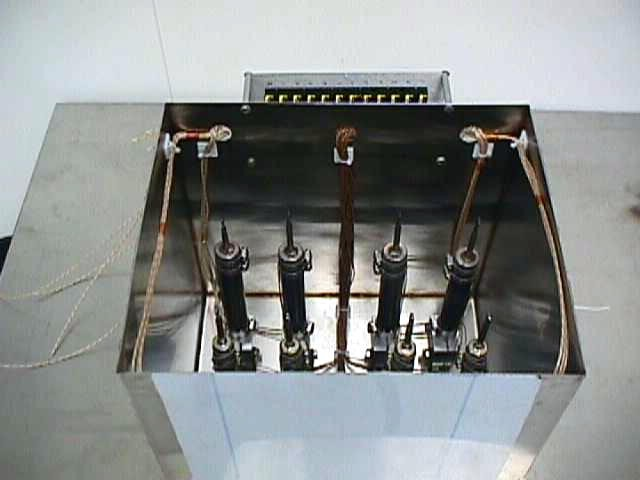 Figure 21.  Titanium/water heat pipes in the test box.  Argon surrounds the heat pipes during testing, to prevent oxidation of the titanium.