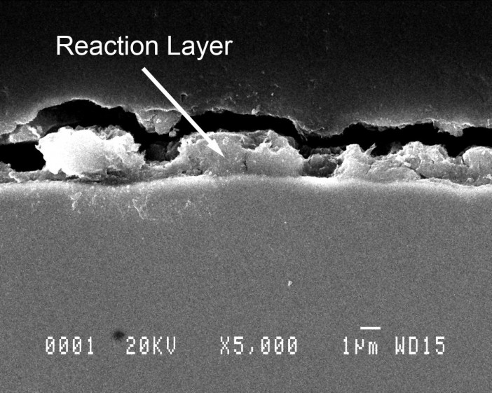 Figure 23.  Secondary Electron Image of C-2000 Envelope/ TiCl4 fluid shows a small reaction layer in this compatible heat pipe.