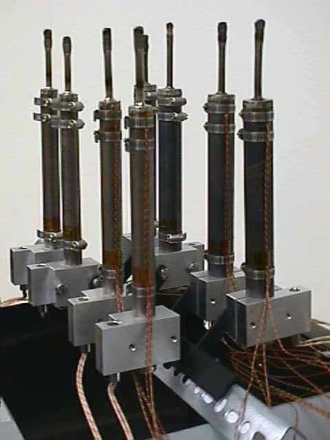 Figure 20. CP-Titanium (on left) and Monel 500 heat pipes set up in heater blocks. The fill tubes are much longer than usual, to allow for multiple purge and reseal.