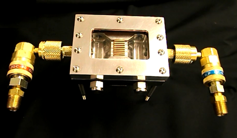 Figure 6. (A) Heat fluxes of up to 250 W/cm2 were removed with this simple mini-channel evaporator with a boiling enhancement coating.