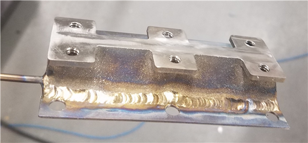 Figure 23. Titanium vapor chamber for SSPA cooling, with bolts to connect to the simulated GaN amplifier plate.